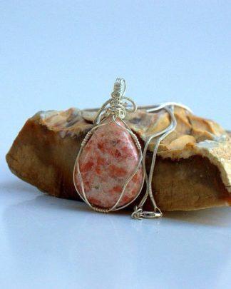Sun stone pendant, sparkly crystal necklace