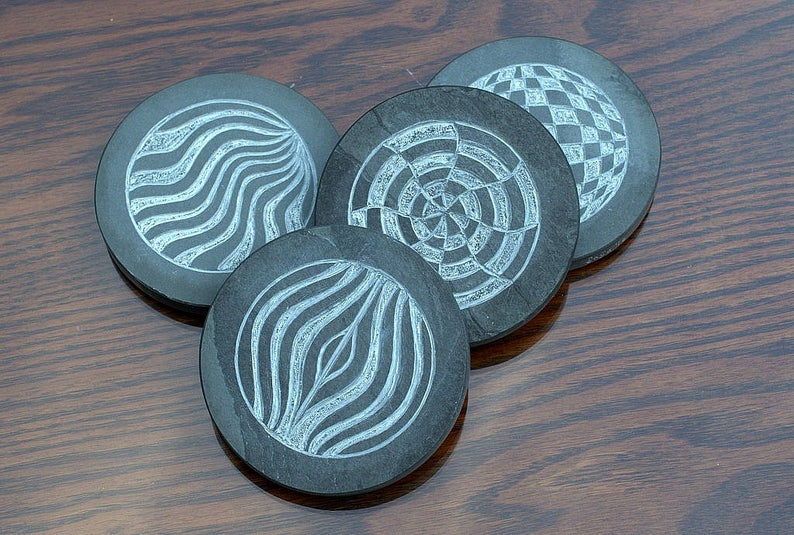Black stone coasters hand carved Op art design