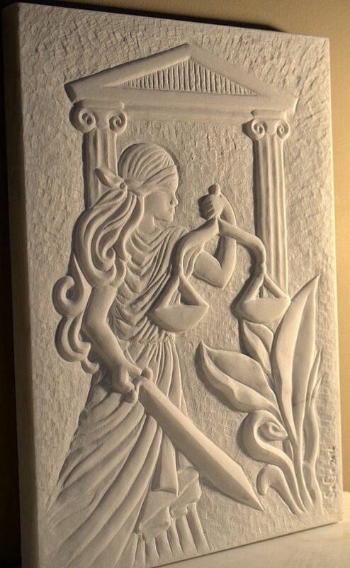Woman with sword and scale stone carving