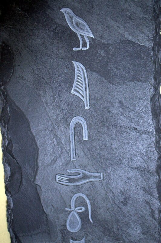 Hand carved stone Egyptian hieroglyph wall art