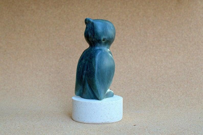 Owl stone figurine, on round limestone base