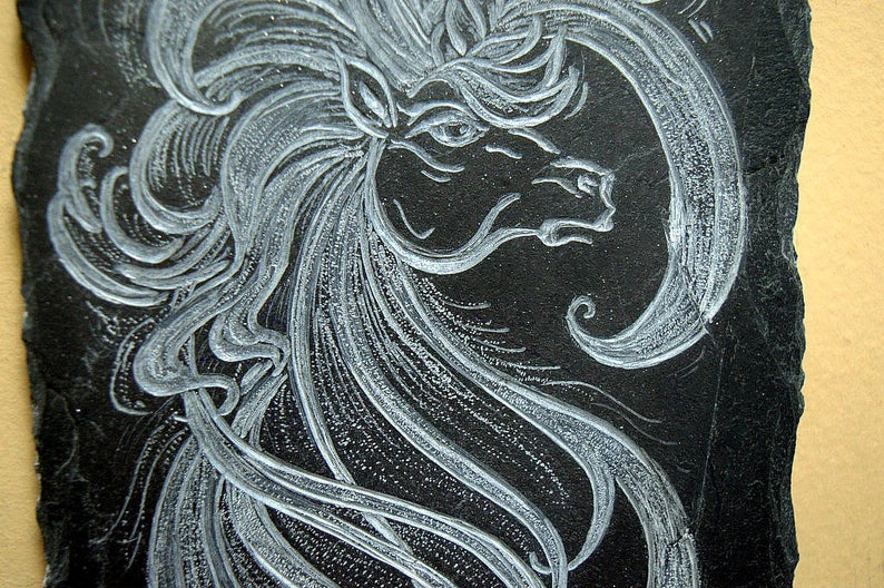 Unicorn carving, antiquated, abstract wall panel