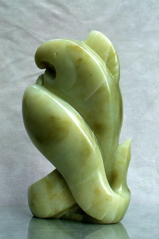 two fishes embracing sculpture