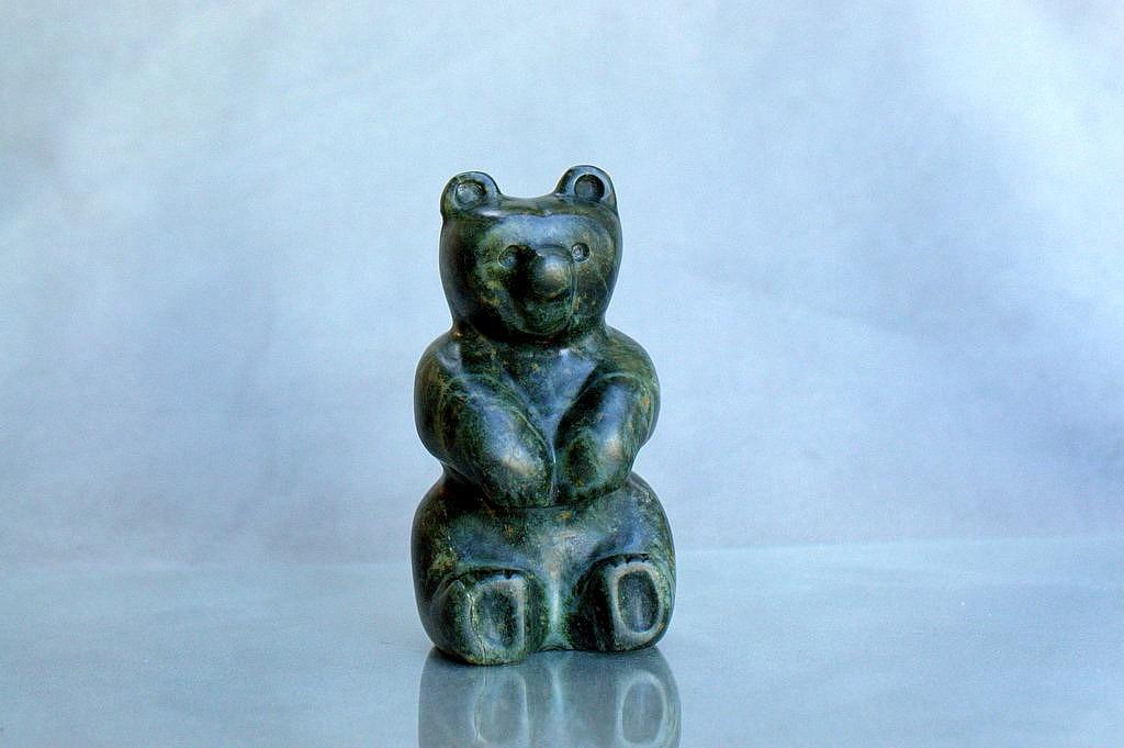Bear cub stone carving
