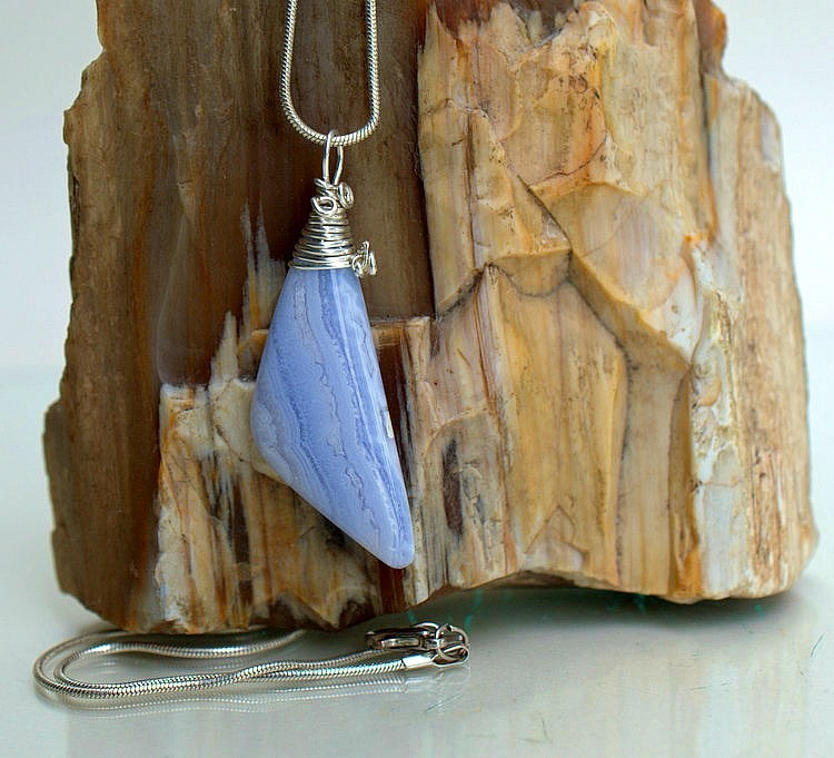 Blue lace agate gemstone with silver cap setting