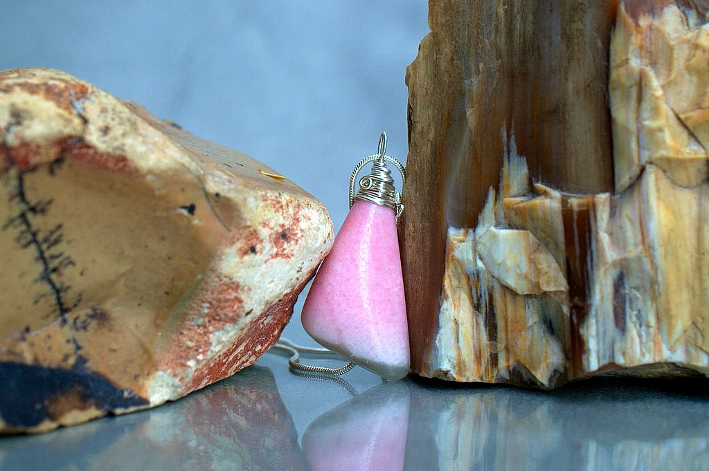 large pink mineral pendant