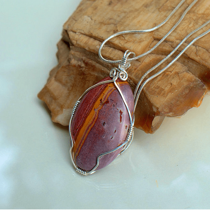 silver wire wrapped red stone