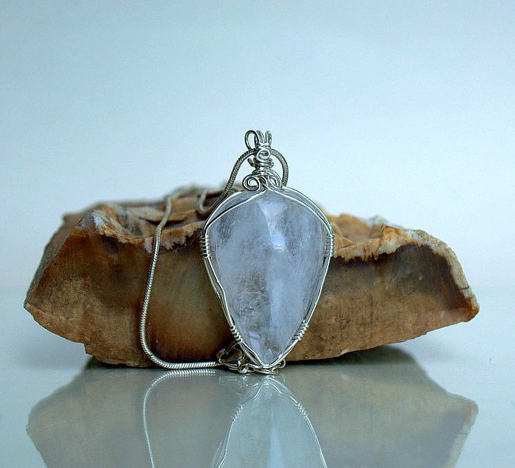 Natural quartz crystal with silver wire wrap setting