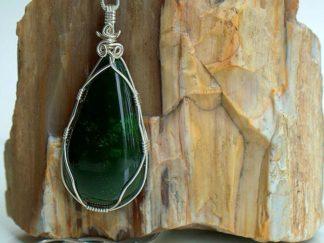 Natural deep green Jade gemstone with silver