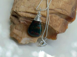 Small size green stone with red dots pendant