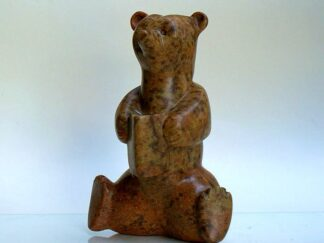 spread leg stone bear holding a book