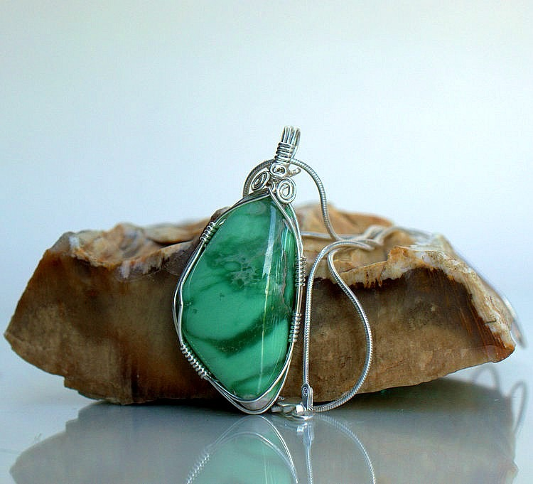Apple green gemstone pendant with silver wire wrapping